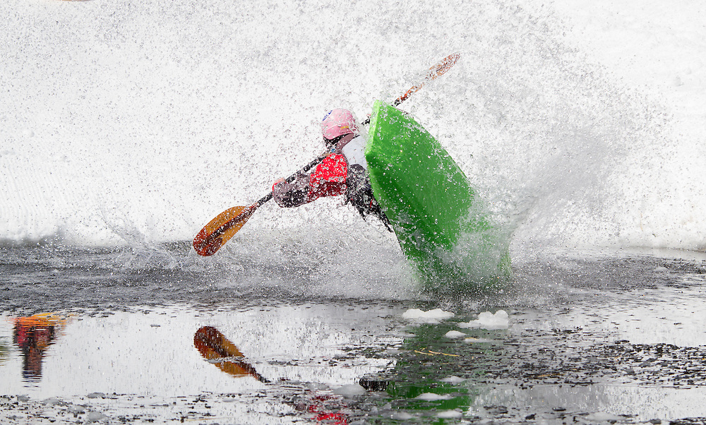 Competitors race down a flume built of snow in the annual Kayaks on the Snow event at Monarch Mountain.