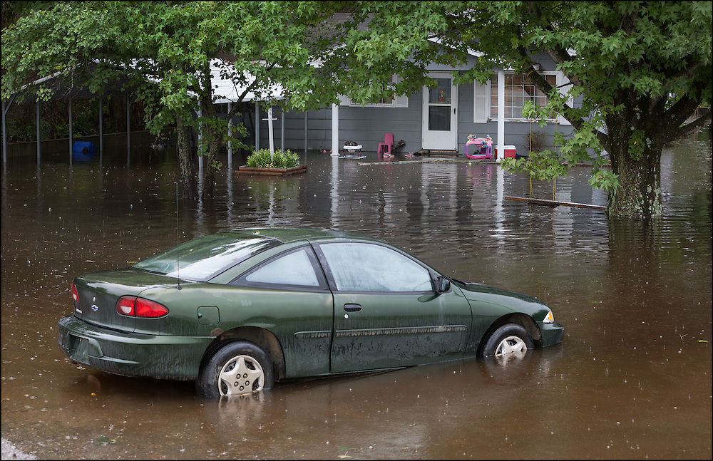 A house in Poplar Bluff, Missouri is on the verge of being submerged by flood waters.
