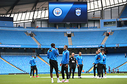 Huddersfield Town players inspect the pitch before the game