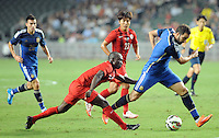 Wisdom Fofo Agbo of Hong Kong, front left, challenges Gonzalo Higuain of Argentina, right, during a friendly football match in Hong Kong, China, 14 October 2014.<br /> <br /> Lionel Messi needed just six minutes to make his mark in Argentina's 7-0 rout of Hong Kong in a friendly at Hong Kong Stadium on Tuesday (14 October 2014). The Barcelona star Messi scored twice after going on as a substitute for the last 30 minutes of the game to celebrate the 100th anniversary of the Hong Kong Football Association. Napoli striker Gonzalo Higuain and Benfica's Nicolas Gaitan also scored two goals each after Sevilla's Ever Banega had opened scoring in the 19th minute.