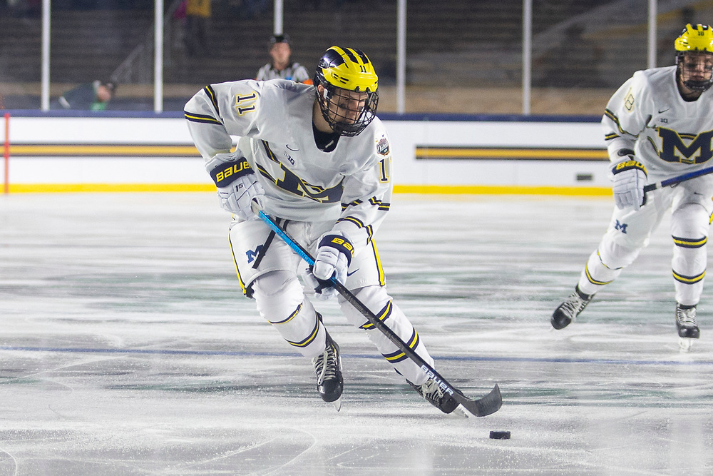 January 05, 2019:  Michigan forward Brendan Warren (11) skates with the puck during NCAA Hockey game action between the Michigan Wolverines and the Notre Dame Fighting Irish at Notre Dame Stadium in South Bend, Indiana.  Michigan defeated Notre Dame 4-2.  John Mersits/CSM