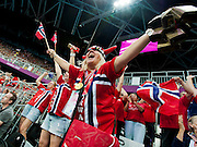 Passionate Norwegian fans urge on their team to victory in the women's handball semi-final against South Korea. The Olympic Park Stratford, London, UK, 9 August 2012.