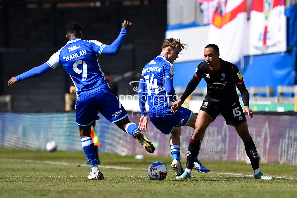 Cohen Bramall (15) of Lincoln City battles for possession with Luke McCormick (14) of Bristol Rovers during the EFL Sky Bet League 1 match between Bristol Rovers and Lincoln City at the Memorial Stadium, Bristol, England on 17 April 2021.