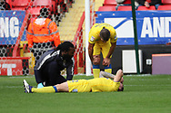 AFC Wimbledon defender Barry Fuller (2) down injured during the EFL Sky Bet League 1 match between Charlton Athletic and AFC Wimbledon at The Valley, London, England on 28 October 2017. Photo by Matthew Redman.