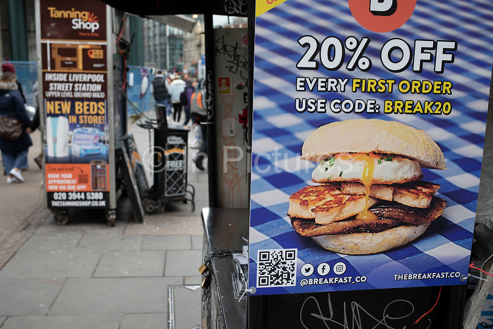 Breakfast in a bun discount offer advertisement showing bread, haloumi, egg and mushrooms on 2nd February 2020 in London, England, United Kingdom. Fast food is a commercial term limited to food sold in a restaurant or store with frozen, preheated or precooked ingredients, and served to the customer in a packaged form for take-out / take-away.