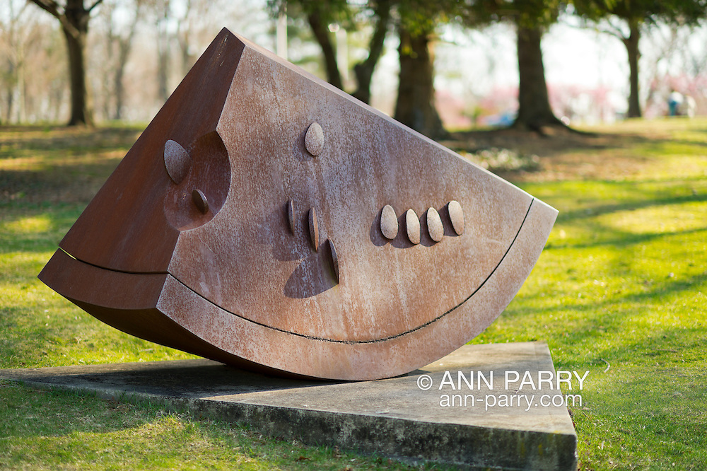 """Roslyn, New York, U.S. - April 12, 2014 - During International Slow Art Day, Sandias (Watermelon), a cor-ten steel sculpture 60""""2102""""x39"""", by sculptor Ana Mercedes Hoyos, is one of many outdoor artworks at the Nassau County Museum of Art on Long Island. During this annual worldwide event, those participating went to local museums and viewed a small number of works of art, each for at least 10 minutes, and then discussed them afterward."""