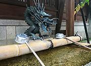 Dragon purification fountain at the Ayaco Tenmangu Shrine, Kyoyo, Japan