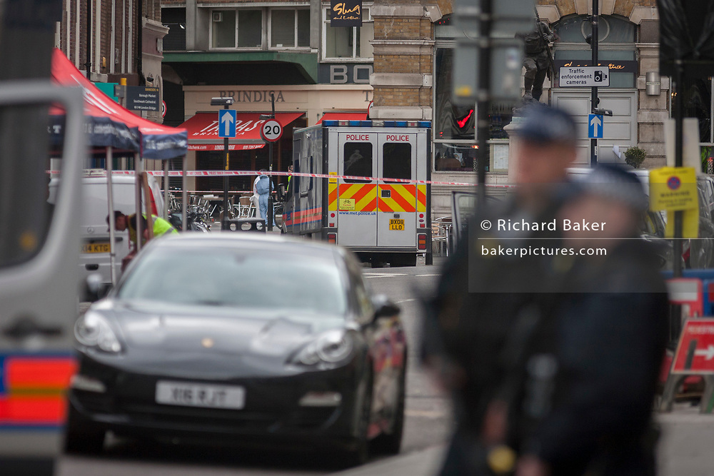 In the aftermath of the London Bridge and Borough Market terrorist attack the previous night, armed police are positioned near the Brindisa tapas bar, the scene of shooting of suspects and in the vicinity of where 7 people were killed and many others injured (Sunday's total). On Sunday 4th June 2017, in the south London borough of Southwark, England.