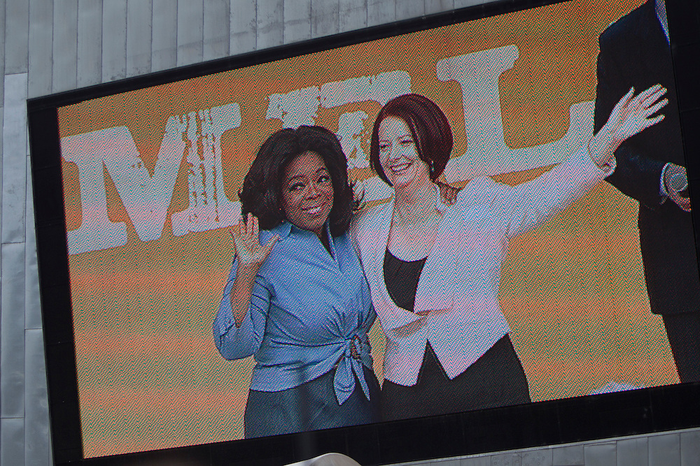 Oprah Winfrey and Australian Prime Minister Julia Gillard wave to the 12,000 strong crowd during a public event at Federation Square on December 10, 2010 in Melbourne, Australia. Oprah Winfrey is in Australia with 302 audience members from the US, Canada and Jamaica and will tape episodes of the 25th and final season of 'The Oprah Winfrey Show' from the Sydney Opera house next week. The shows will air in the US and Australia in January 2011.