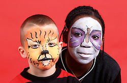 Portrait of young boy and girl with painted faces,