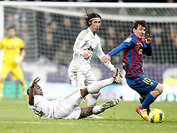 10.12.2011, Santiago Bernabeu Stadion, Madrid, ESP, Primera Division, Real Madrid vs FC Barcelona, 15. Spieltag, im Bild Real Madrid's Lass Diarra and Sergio Ramos against Barcelona's Lionel Messi // during the football match of spanish 'primera divison' league, 15th round, between Real Madrid and FC Barcelona at Santiago Bernabeu stadium, Madrid, Spain on 2011/12/10. EXPA Pictures © 2011, PhotoCredit: EXPA/ Alterphotos/ Alvaro Hernandez..***** ATTENTION - OUT OF ESP and SUI *****