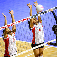 111413  Adron Gardner/Independent<br /> <br /> Shiprock Chieftains Melyssa Harwood (15), left, and Katura Garcia (12) rise to block Raton Tiger Dorrance Shania (3) during the state volleyball tournament at the Santa Ana Star Center in Rio Rancho Thursday.