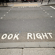 Look right caution on streets of downtown London. Since they drive on the left in Britain but on the right on the European continent, many European tourists in London don't automatically look the correct way when crossing the street.