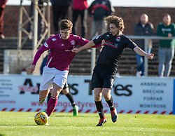 Arbroath's Michael McKenna and Clyde's Raymond Grant. half time : Arbroath 0 v 1 Clyde, Tunnocks Caramel Wafer Challenge Cup 4th Round, played 12/10/2019 at Arbroath's home ground, Gayfield Park.
