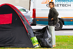 A woman is seen outside her tent at Marble Arch. Over the last few years London has seen increasing numbers of Eastern European beggars and street performers on its streets as they flock to the UK and other wealthier countries to take advantage of people's generosity. London, August 02 2019.