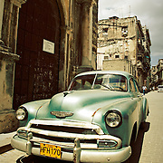 A vintage American made car parked on the streets of Havana, Cuba.<br />