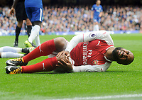 Football - 2017 / 2018 Premier League - Chelsea vs. Arsenal<br /> <br /> Alexandre Lacazette of Arsenal is feels the pain after being fouled by Victor Moses of Chelsea, at Stamford Bridge.<br /> <br /> COLORSPORT/ANDREW COWIE