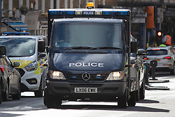 © Licensed to London News Pictures. 13/03/2021. London, UK. An armoured police van arrives at Westminster Magistrates Court where today Wayne Couzens is expected to appeared in custody. He is charged with the murder and kidnapping of Sarah Everard.  Photo credit: George Cracknell Wright/LNP