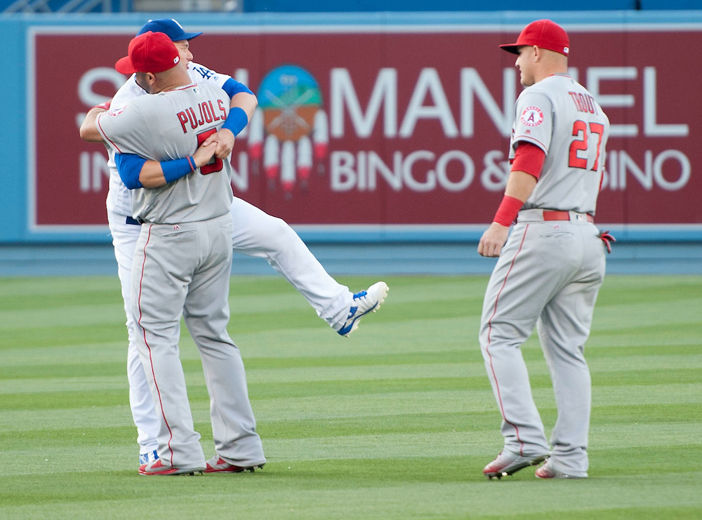 The Angels' Albert Pujols hugs the Dodgers' Joc Pederson as Mike Trout stands by before the Angels' loss Tuesday night at Dodger Stadium.<br /> <br /> / //ADDITIONAL INFO:   <br /> <br /> angels.0518.kjs  ---  Photo by KEVIN SULLIVAN / Orange County Register  -- 5/17/16<br /> <br /> The Los Angeles Angels take on the Los Angeles Dodgers in inter-league play at Dodger Stadium Tuesday night.