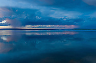 A storm on the horizon during sunset over Yellowstone Lake in Yellowstone National Park, Wyoming.