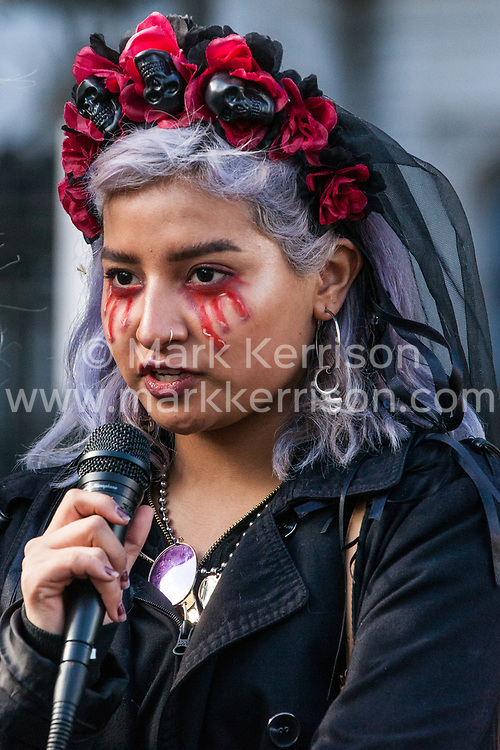 London, UK. 9th March, 2019. A young activist addresses climate activists from Extinction Rebellion after they poured artificial blood on the ground outside Downing Street as part of an act of civil disobedience named 'The Blood of Our Children' to call on the Government to take immediate steps to combat the current climate and ecological emergency.