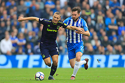 Everton's Nikola Vlasic (right) and Brighton & Hove Albion's Shane Duffy battle for the ball during the Premier League match at the AMEX Stadium, Brighton.