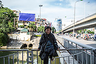 A homeless man in Cau Giay District grins at the camera, Hanoi, Vietnam, Southeast Asia