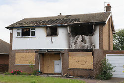 House boarded up after a fire,