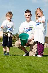 NatWest Staff members and family were on hand at Drax Cricket Club, Yesterday (Sunday 10 April 2011) to help with a clean up and  restoration ready for the start of the cricket season. Helping reseed areas of the cricket pitch are David Ellis with his Children Charlotte Ellis and Luke Ellis..10 April 2011.Images © Paul David Drabble
