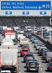 © Licensed to London News Pictures. 25/08/2017. London, UK. Long Queues of Traffic build up on the M25 northbound near Heathrow Airport, as the August bank holiday begins. Road and rail services are being affected by maintenance work this weekend - one of the busiest in the year. Photo credit: Ben Cawthra/LNP