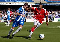 Photo: Ashley Pickering.<br /> Colchester United v Charlton Athletic. Coca Cola Championship. 15/09/2007.<br /> Jerome Thomas of Charlton (R) holds off Colchester goal scorer Mark Yeates