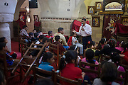 A morning religious lesson held for local Christian children at St Tawdros (St Theodore's) Coptic Orthodox Christian Monastery, Luxor, Nile Valley, Egypt. The Copts are an ethno-religious group in North Africa and the Middle East, mainly in the area of modern Egypt, where they are the largest Christian denomination. Christianity was the religion of the vast majority of Egyptians from 400–800 A.D. and the majority after the Muslim conquest until the mid-10th century. Today, there are an extimated 9-15m Copts in Egypt.