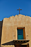 SHOT 12/30/17 4:20:36 PM - The First Presbyterian Church in Taos, N.M. Adobe is a building material made from earth and other organic materials. Adobe means mudbrick in Spanish, but in some English-speaking regions of Spanish heritage, the term is used to refer to any kind of earth construction. Most adobe buildings are similar in appearance to cob and rammed earth buildings. Adobe is among the earliest building materials, and is used throughout the world. Taos is a town in Taos County in the north-central region of New Mexico in the Sangre de Cristo Mountains, incorporated in 1934. As of the 2010 census, its population was 5,716 and is known for the historic Taos Pueblo and more recently as an artist enclave. (Photo by Marc Piscotty / © 2017)