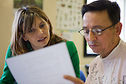 A prisoner working with his teacher during one of his classes. HMP The Mount, Bovingdon, Hertfordshire
