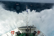 A ships bow hitting a wave enroute to Antarctica