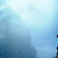 Mountaineer John Fischer stands atop a crag below Mount Humphreys on the crest of California's Sierra Nevada.