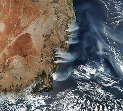 December 4, 2019 - Australia - Bushfires in south and eastern Australian states started growing in number through October 2019, and have since sent smoke halfway around the world. As of early December, the fires continued to rage. The fires burned near the coast of New South Wales, near Canberra and areas north to the border with Queensland. According to the New South Wales Rural Fire Service, 116 bush and grass fires were actively burning around the time of this image; 60 of them were uncontained. (Credit Image: © NASA Earth/ZUMA Wire/ZUMAPRESS.com)