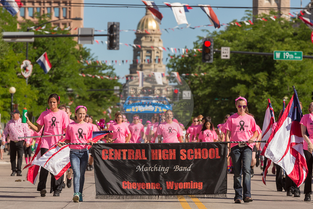 A marching band during the Cheyenne Frontier Days parade past the state capital building July 23, 2015 in Cheyenne, Wyoming. Frontier Days celebrates the cowboy traditions of the west with a rodeo, parade and fair.