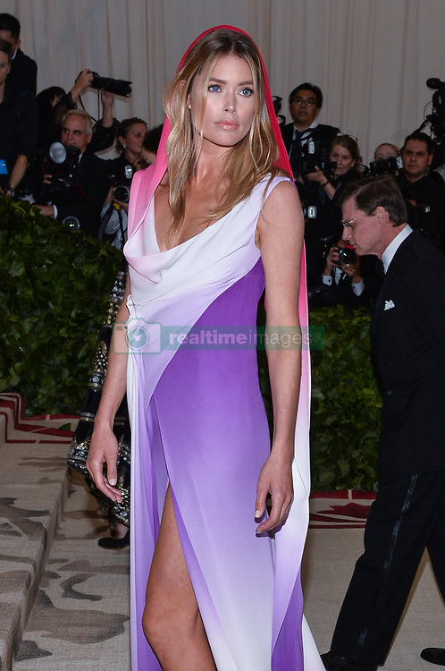 Doutzen Kroes walking the red carpet at The Metropolitan Museum of Art Costume Institute Benefit celebrating the opening of Heavenly Bodies : Fashion and the Catholic Imagination held at The Metropolitan Museum of Art  in New York, NY, on May 7, 2018. (Photo by Anthony Behar/Sipa USA)