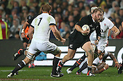 Owen Franks of the All Blacks on the charge during the third rugby test between the All Blacks and England played at Waikato Stadium in Hamilton during the Steinlager Series - All Blacks v England, Hamiton, 21 June 2014<br /> www.photosport.co.nz