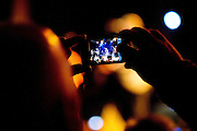 A fan takes a photo on their cell phone as the English Beat performs at the Granada Theater on Saturday, January 19, 2013 in Dallas, Tx. (Cooper Neill/The Dallas Morning News)