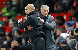 Manchester City manager Pep Guardiola (left) and Manchester United manager Jose Mourinho after the final whistle of the Premier League match at Old Trafford, Manchester.