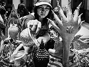 """11 APRIL 2017 - BANGKOK, THAILAND: Women bath a statue of the Buddha in scented water during the Songkran travel period at Hua Lamphong train station in Bangkok. Songkran is the traditional Thai Lunar New Year. It is celebrated, under different names, in Thailand, Myanmar, Laos, Cambodia and some parts of Vietnam and China. In most places the holiday is marked by water throwing and water fights and it is sometimes called the """"water festival."""" This year's Songkran celebration in Thailand will be more subdued than usual because Thais are still mourning the October 2016 death of their revered Late King, Bhumibol Adulyadej. Songkran is officially a three day holiday, April 13-15, but is frequently celebrated for a full week. Thais start traveling back to their home provinces over the weekend; busses and trains going out of town have been packed.     PHOTO BY JACK KURTZ"""