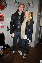 JAMES COOK and POPPY DELEVIGNE at a party to celebrate the opening of Barts, Sloane Ave, London on 26th February 2009.