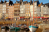 photo of Harbour side restauarant - La Bisquine . Honfleur, Normandy, France. . Honfleur is especially known for its old port, characterised by its houses with slate-covered frontages, painted many times by artists, including in particular Gustave Courbet, Eugène Boudin, Claude Monet and Johan Jongkind, forming the école de Honfleur (Honfleur school) which contributed to the appearance of the Impressionist movement. .<br /> <br /> Visit our FRANCE HISTORIC PLACES PHOTO COLLECTIONS for more photos to download or buy as wall art prints https://funkystock.photoshelter.com/gallery-collection/Pictures-Images-of-France-Photos-of-French-Historic-Landmark-Sites/C0000pDRcOaIqj8E