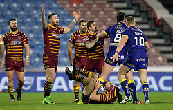 Huddersfield Giants Danny Brough and Warrington's Chris Hill confront each other during the Betfred Super League match at the Kirklees Stadium, Huddersfield.