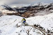 A rider ploughs through the snow on stage one of the Kinlochleven Enduro.