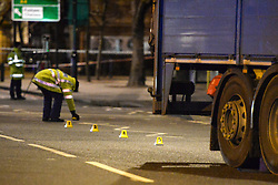 © Licensed to London News Pictures. 18/01/2018. London, UK. An investigation team at the scene in Knightsbridge, London, where a woman died after being hit by a lorry on Brompton Road  shortly before 6pm between the Victoria and Albert Museum and Harrods. Photo credit: Guilhem Baker/LNP
