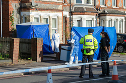 © Licensed to London News Pictures. 12/11/2020. Reading, UK. Police officers and forensic investigators stand next to a forensic tent inside a property where a man died in the early hours of Thursday. Thames Valley Police is investigating the unexplained  death of a man in Reading. At approximately 04:55GMT South Central Ambulance Service called police officers to a house on Oxford Road, Reading. On attendance they found that a man in his fifties had died. A 44-year-old man, a 38-year-old man and a 43-year-old man all from Reading have been arrested on suspicion of murder. Photo credit: Peter Manning/LNP