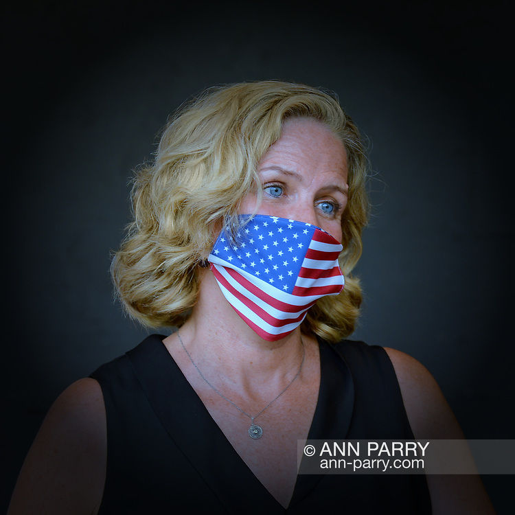 East Meadow, New York, U.S. September 10, 2020. Nassau County Executive LAURA CURRAN wears a face mask with American flag design, during the COVID-19 pandemic, at the county Remembrance Ceremony at Eisenhower Park commemorating 19th anniversary of September 11, 2001 terrorist attacks. The names of the 348 county residents killed were read on stage. Vignette added.